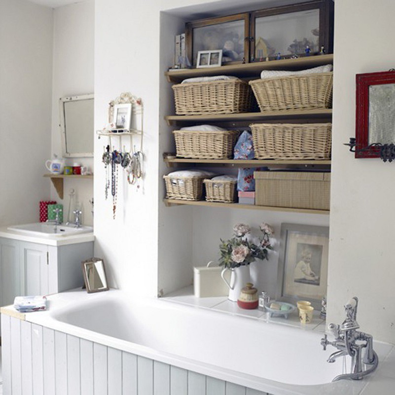 Small Bathroom Shelf Ideas For Creative Bathroom Storage On a Budget - Great idea for shelves over the bathtub in this bathroom. LOVE the baskets!