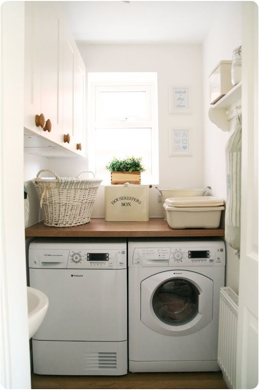 Tiny laundry room idea:  Solid shelf over the washer/dryer and lots of cabinets on side wall make this a great small laundry room layout.