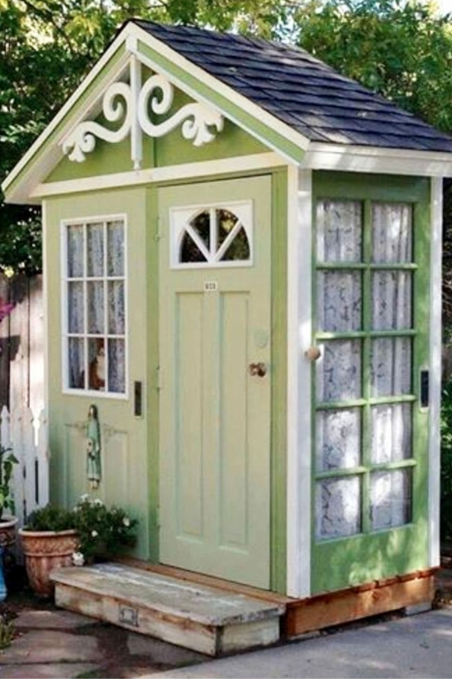 She Shed Ideas We LOVE - This She Shed Garden Shed Is made From Old Doors - What a Clever DIY Repurposed Upclycled Outdoor Building Idea!