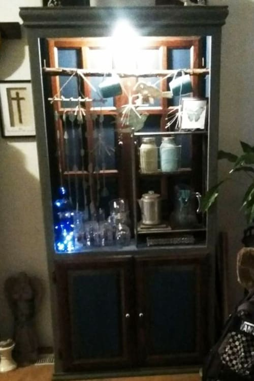 Converting a china cabinet into a beautiful keepsake - this old, run down hutch belonged to her mother in law and she converted it into a keepsake treasure!