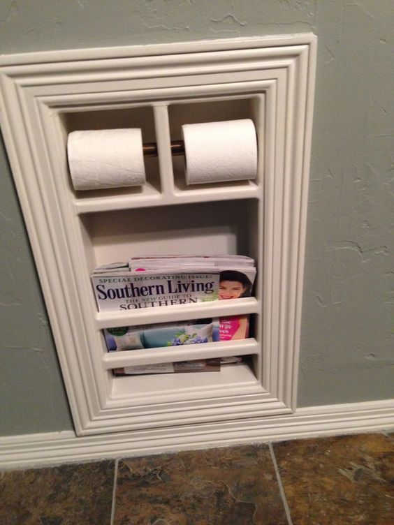 bathroom storage ideas for organizing all the small spaces in your tiny bathroom - built in toilet paper holder and magazine holder - bathroom organization ideas