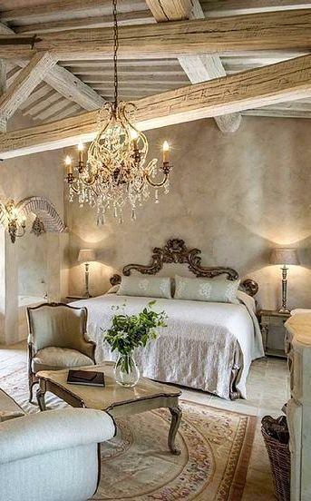stunning master bedroom - rustic mixed with a shabby chic design idea.  Love the pallet/ exposed wood beams and vaulted ceiling...and LOVE the bedroom chandelier over the bed.