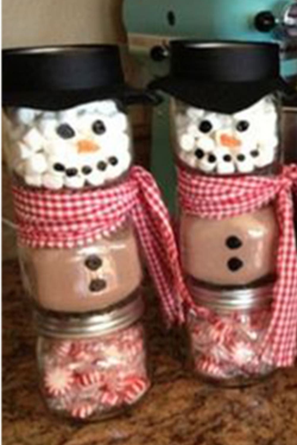 Mason Jar Christmas Gifts and Crafts - Easy Mason Jar Christmas Gift Ideas for Homemade Holiday Gifts for Neighbors, teachers, friends, co-workers and family. Easy DIY Christmas mason jars and Christmas mason jar decorating ideas - how to decorate mason jars for Christmas gifts - DIY Mason Jar Gifts and Cute Mason Jar Ideas For Christmas Presents - Snowmen made out of mason jars