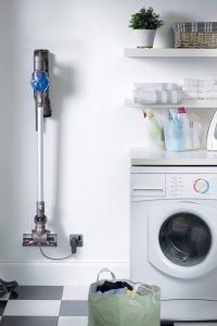 I just LOVE my cordless Dyson vacuum cleaner! AND it sure looks cool hanging on the wall in my laundry room too!