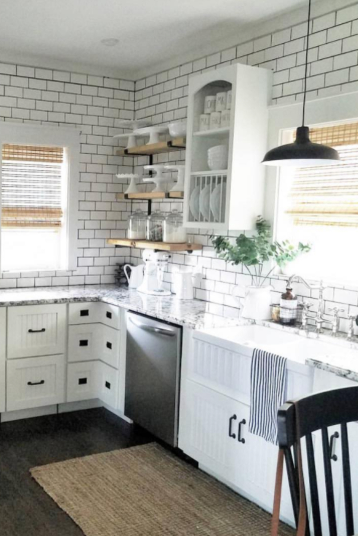 This kitchen is just STUNNING with the use of subway tile, open shelving, open kitchen cabinets, big white farmhouse sink and updates everywhere.  What a great DIY kitchen makeover idea!