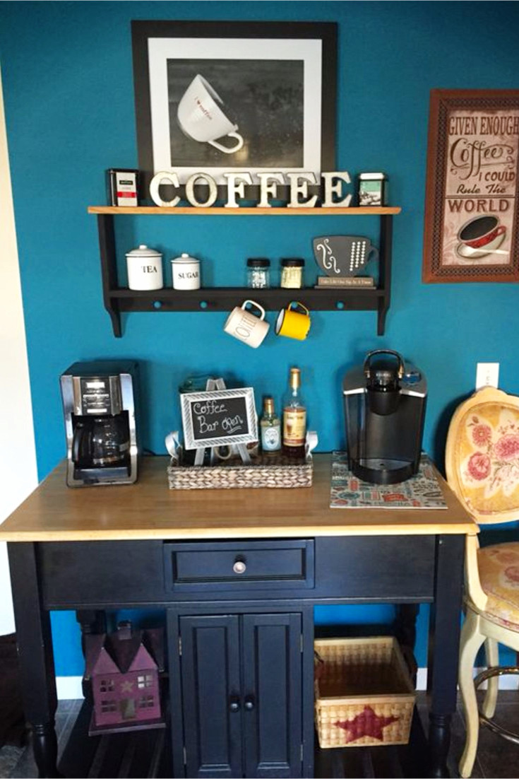 Love the blue wall behind this corner kitchen coffee nook!