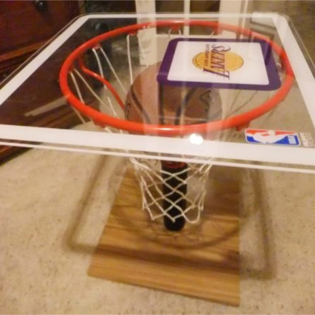Convert a basketball net and backboard into a cool table for a garage man cave #mancaveideas #garagemancave #diyhomedecor