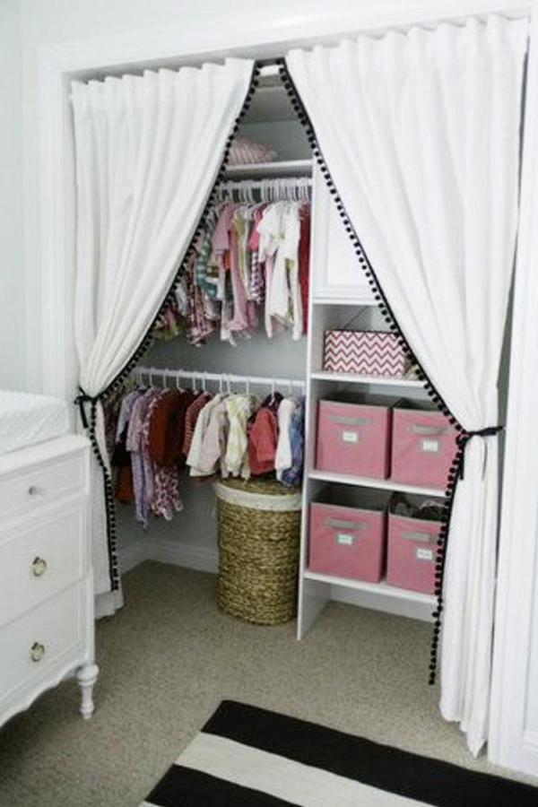 This baby room closet idea is one of my favorites.  I love the idea of making a nursery closet bigger and more usable by removing the closet door(s), but adding this curtain is just brilliant.  Very simple DIY hack that will fit any budget.