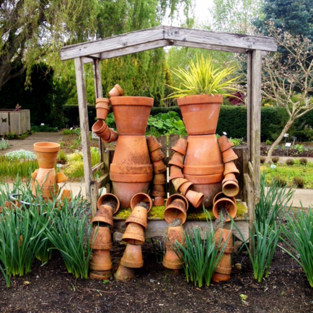LOVE these clay pot people made out of flower pots!