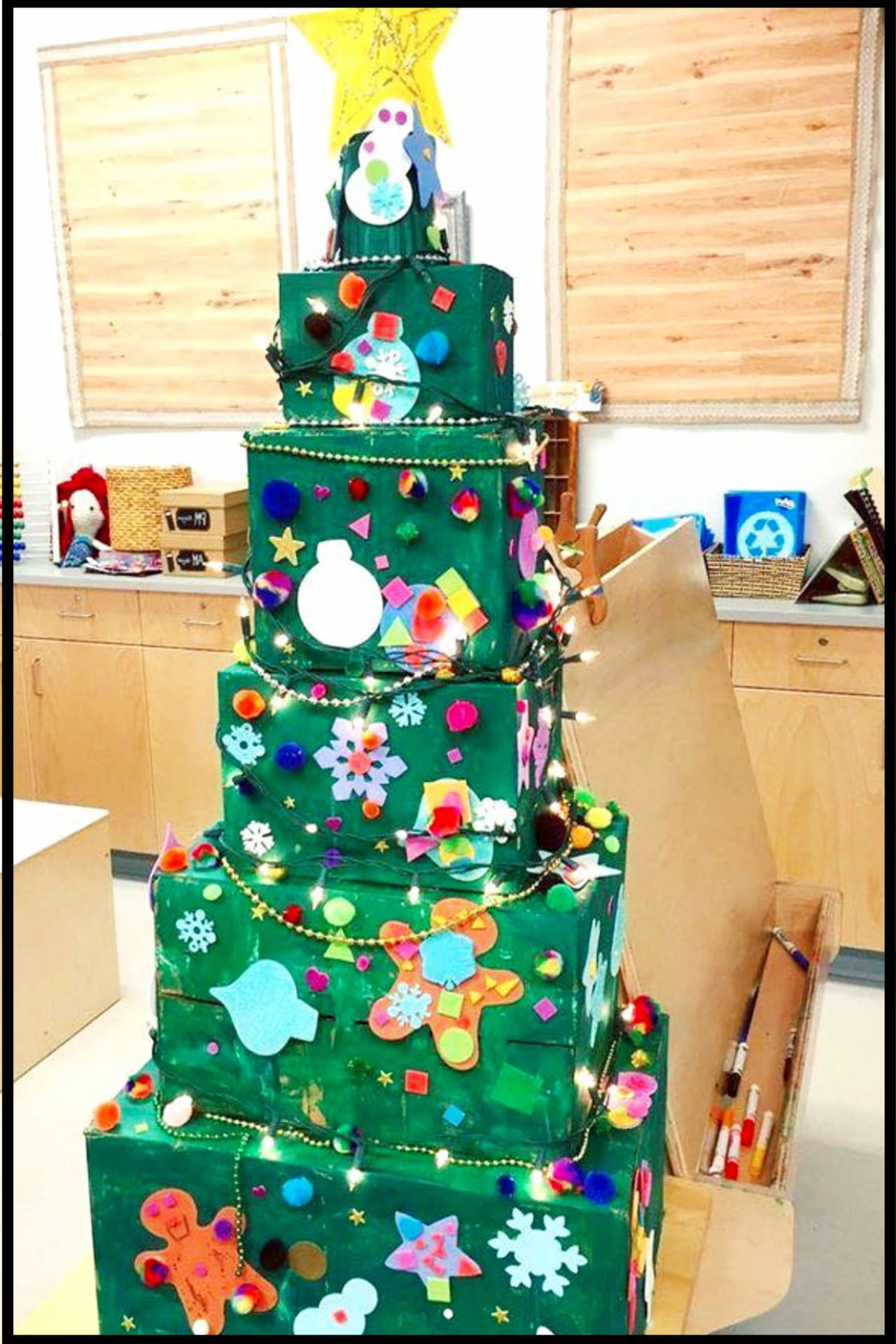 Classroom Christmas Crafts for Kids - LOVE this Christmas tree craft project for the kids in Prek, Kindergarten, Daycare etc - stack boxes in a Christmas tree shape, paint, and let the kids decorate with their Christmas paper crafts